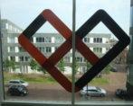 Raambelettering freesletter kantoorpand raam