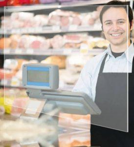 preventiescherm van plexiglas voor bescherming van werknemers of kassamedewerkers aan de balie of kassa van een winkel